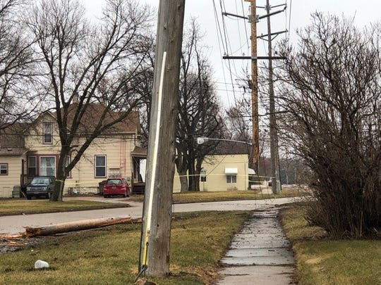 The bottom of a pole was shorn off Thursday morning after it was struck by a car.