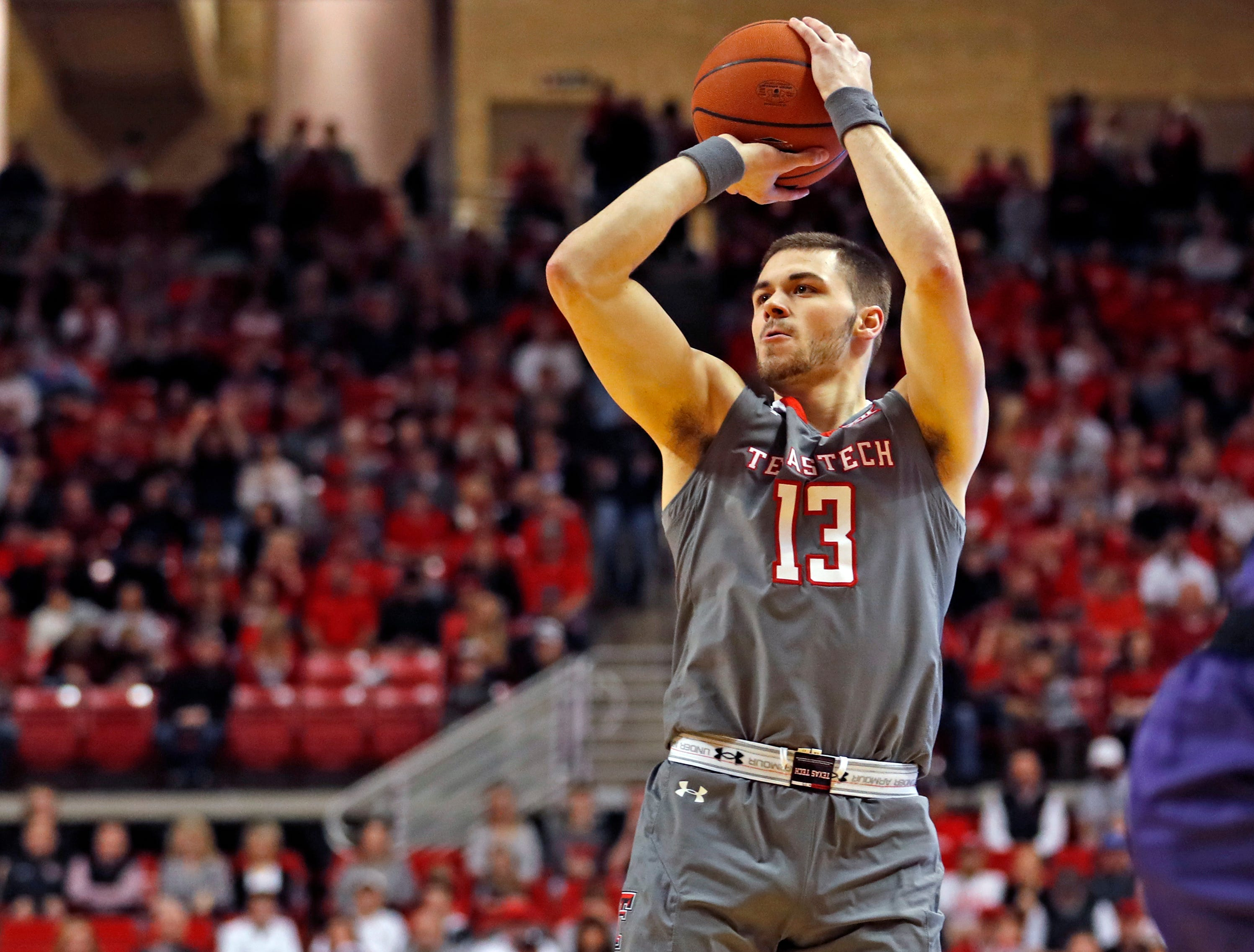 Texas Tech's Matt Mooney (13) shoots the ball for three points during the first half of an NCAA college basketball game against Kansas State, Saturday, Jan. 5, 2019, in Lubbock, Texas. (AP Photo/Brad Tollefson)