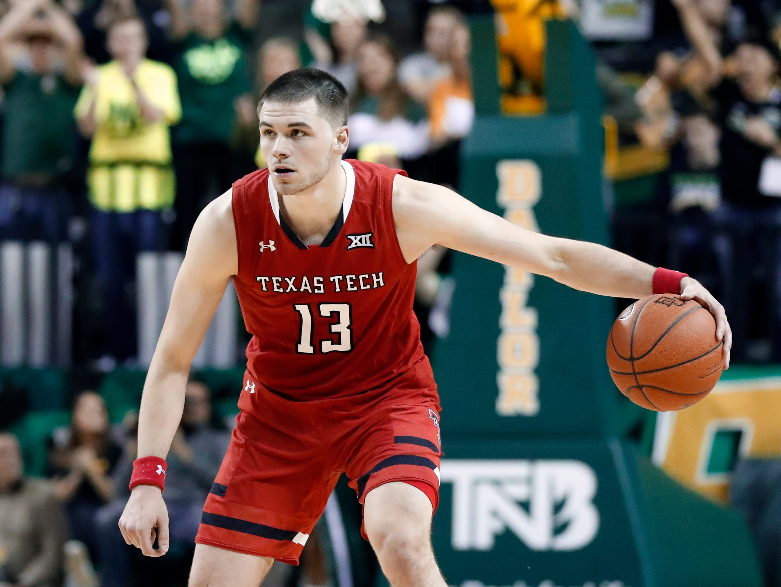 Texas Tech guard Matt Mooney (13) handles the ball during an NCAA college basketball game against Baylor on Saturday, Jan. 19, 2019, in Waco, Texas. (AP Photo/Tony Gutierrez)