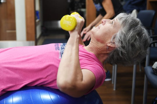 Molly Liberko, boxing name Mad Molly, participates in the Rock Steady Boxing class Wednesday, April 3, with instructor Lisa Howard at The Inn on Westport in Sioux Falls. The program was designed to help people with Parkinson's disease.