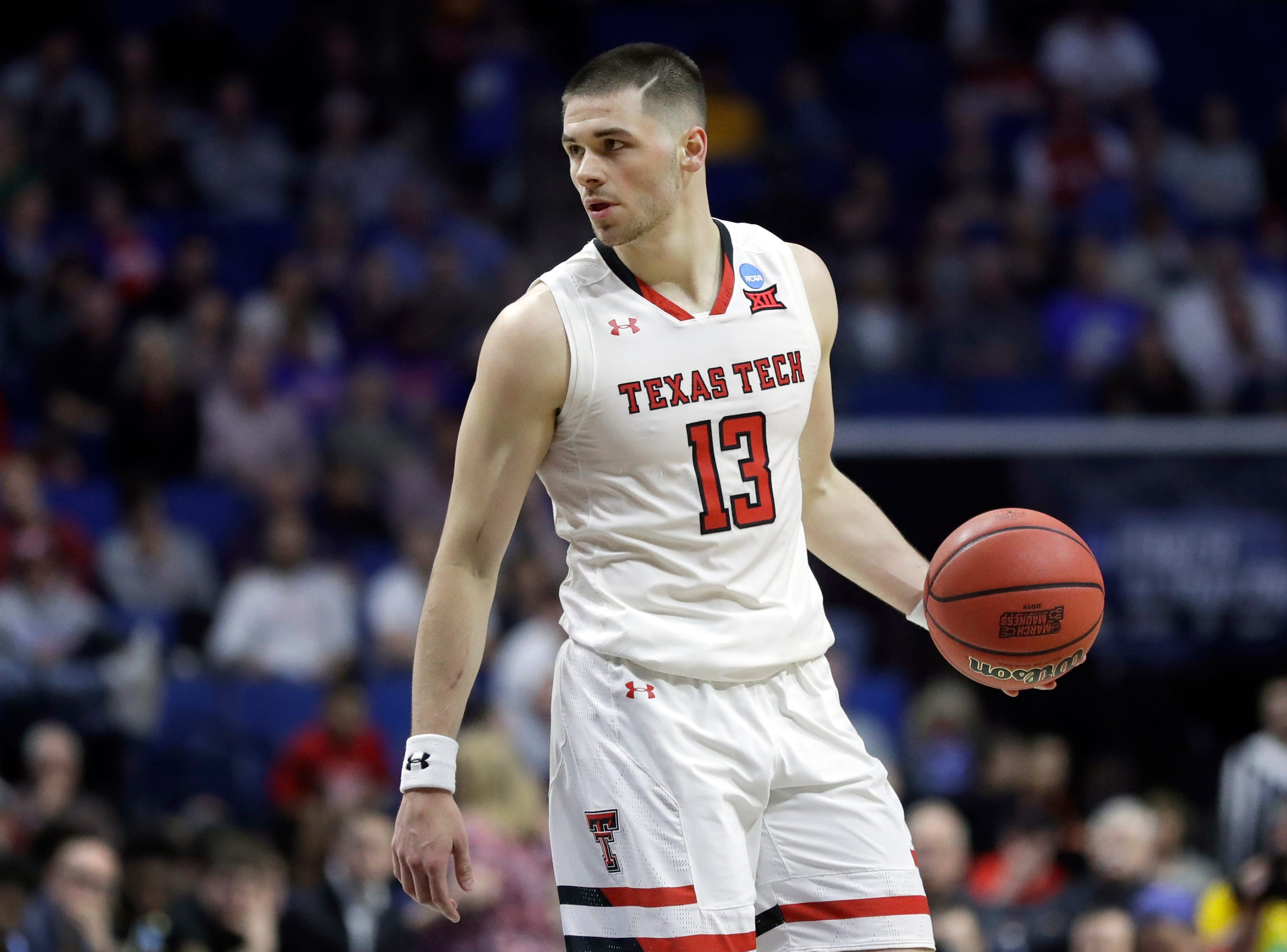 Texas Tech's Matt Mooney brings the ball down the court during the second half of a first round men's college basketball game against Northern Kentucky in the NCAA Tournament Friday, March 22, 2019, in Tulsa, Okla. Texas Tech won 72-57. (AP Photo/Jeff Roberson)