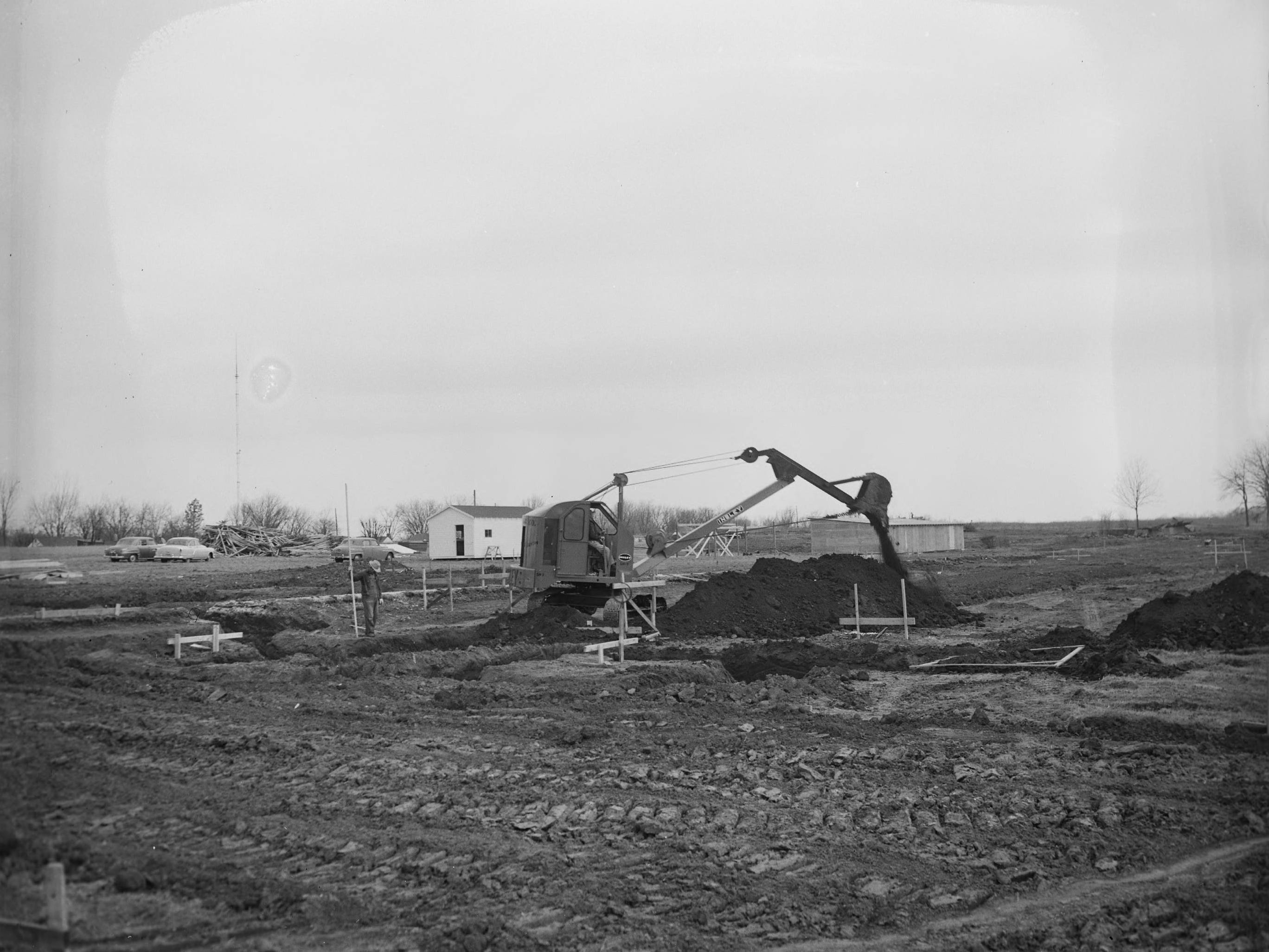 Heavy machinery being used to grade the land for the construction of Parkview High School. Published in the Leader & Press on April 4, 1955.