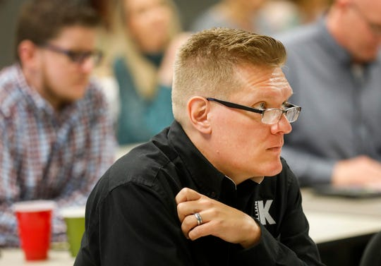 Layton Jones, the safety manager at Killian Construction Co., listens to a speaker during the Legalization & the Workforce event at the Missouri Career Center on Thursday, April 4, 2019.