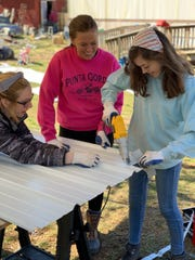 Volunteers at a project for Renewing Home of Greater Augusta.