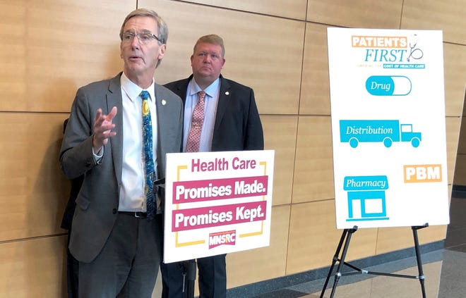Minnesota State Sen. Scott Jensen, R-Chaska, left, discusses Senate GOP-backed health care legislation at a news conference on Thursday, April 4, 2019 in St. Paul, Minn. Jensen is chief author of a bill regulating pharmacy benefit managers that passed the Senate later the same day. (AP Photo/Steve Karnowski)