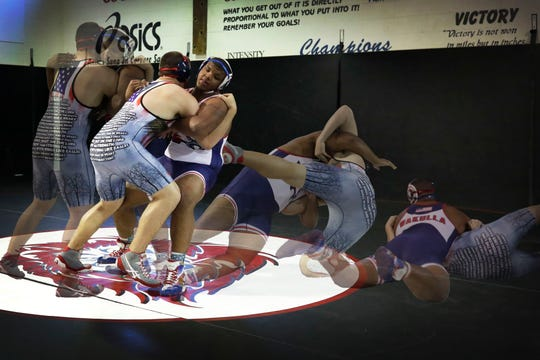 Photo Illustration: Wakulla senior heavyweight Darius Wilkins is the 2019 All-Big Bend Wrestler of the Year after going 58-4 and finishing second in Class 1A amid the War Eagles' record season.