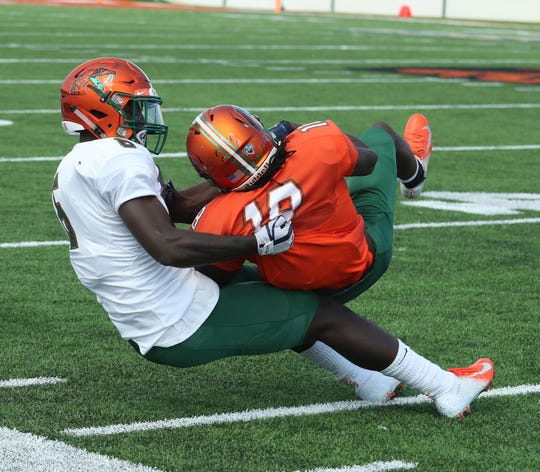 FAMU safety Markquese Bell tackles  Ferante Cowart in the Orange & Green Game on Saturday, March 30, 2019 at Bragg Memorial Stadium.