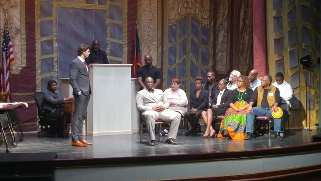 """""""Justice on Trial"""" creator Chad Lawson Cooper (seated), portraying Medger Evers, in this scene at Macon, Georgia's Douglass Theatre."""