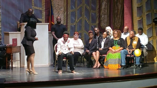 "An actor portraying Emmett Till (seated center) in a scene from the play ""Justice on Trial: Black Lives Matter, Too"" on a Brooklyn stage in February."