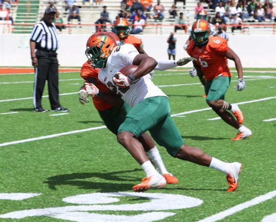 Ricky Henrilus bounces outside and breaks free in the Orange & Green Game on Saturday, March 30, 2019 at Bragg Memorial Stadium.