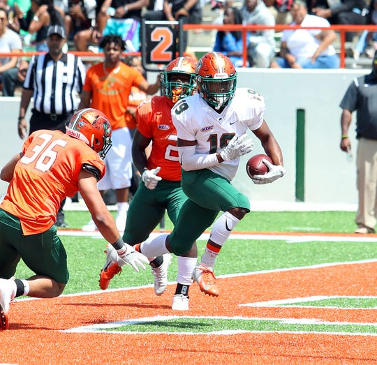 FAMU wide receiver Xavier Smith scores a touchdown in the Orange & Green Game on Saturday, March 30, 2019.