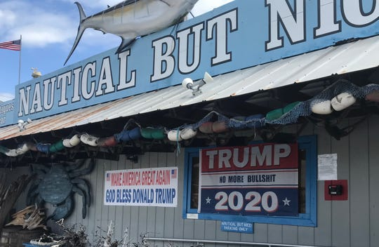 A banner outside the Stuart gift shop Nautical But Nice conveys the owners' political views - to the chagrin of some who object to the vulgarity.