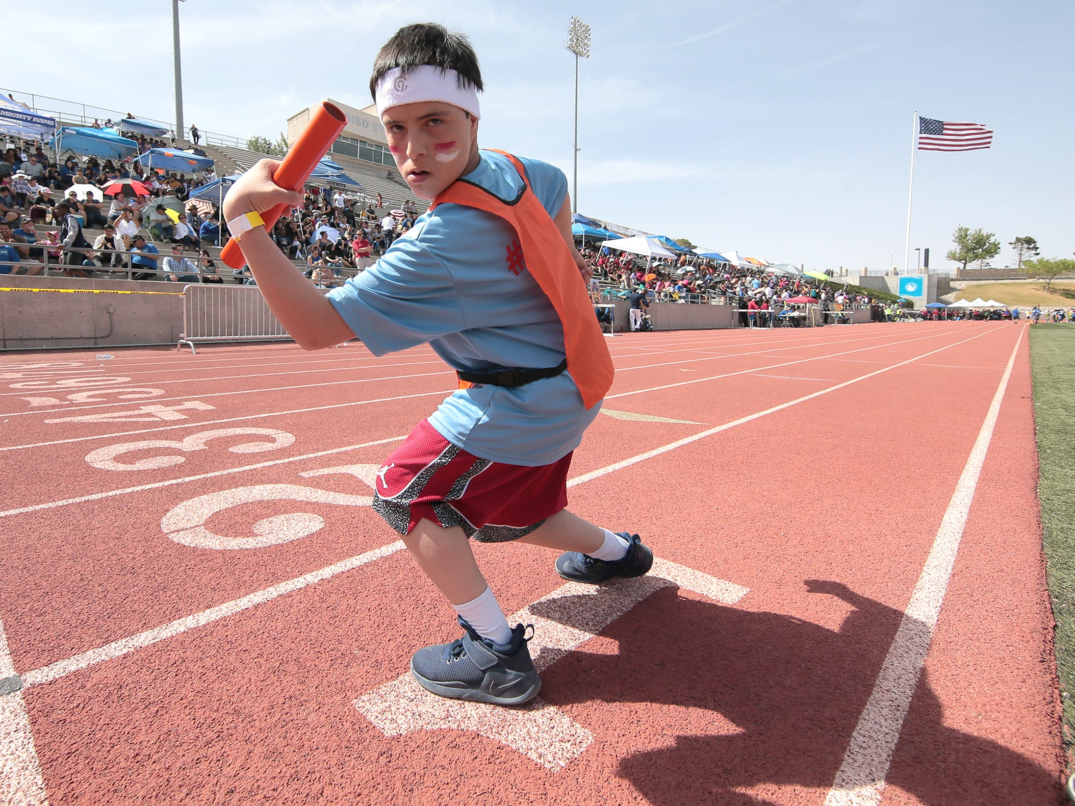 Oscar Rivera flexes before starting the 4x100-meter relay at the Socorro Independent School District Spring Games at the Student Activities Complex on Wednesday, April 3, 2019. High-fives and hugs awaited finishers as they dashed past cheerleaders and drum lines that lined the entire 100-meter homestretch. More than 1,000 students with special needs participated in the district's annual Spring Games. They competed in a variety of track events. Smiles filled their faces as they made their way to the finish line.