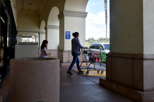 Teresa Zepeda, of Oxnard, leaves a Walmart store in Camarillo after shopping trip with her daughter. Assembly Bill 161, a measure aimed at reducing paper waste, would bar retailers from issuing paper receipts unless requested by a customer.