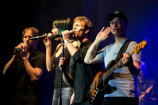 Members of The Lt. Dan Band (from left) Dan Myers, Molly Callinan, Jeff Vezain and Gary Sinise perform at Little Rock Air Force Base in Arkansas on April 29, 2016. The band, which is associated with the Sinise's charity foundation and the United Service Organizations, perform more than 40 concerts for military members and their families each year. (U.S. Air Force photo by Master Sgt. Jeff Walston)