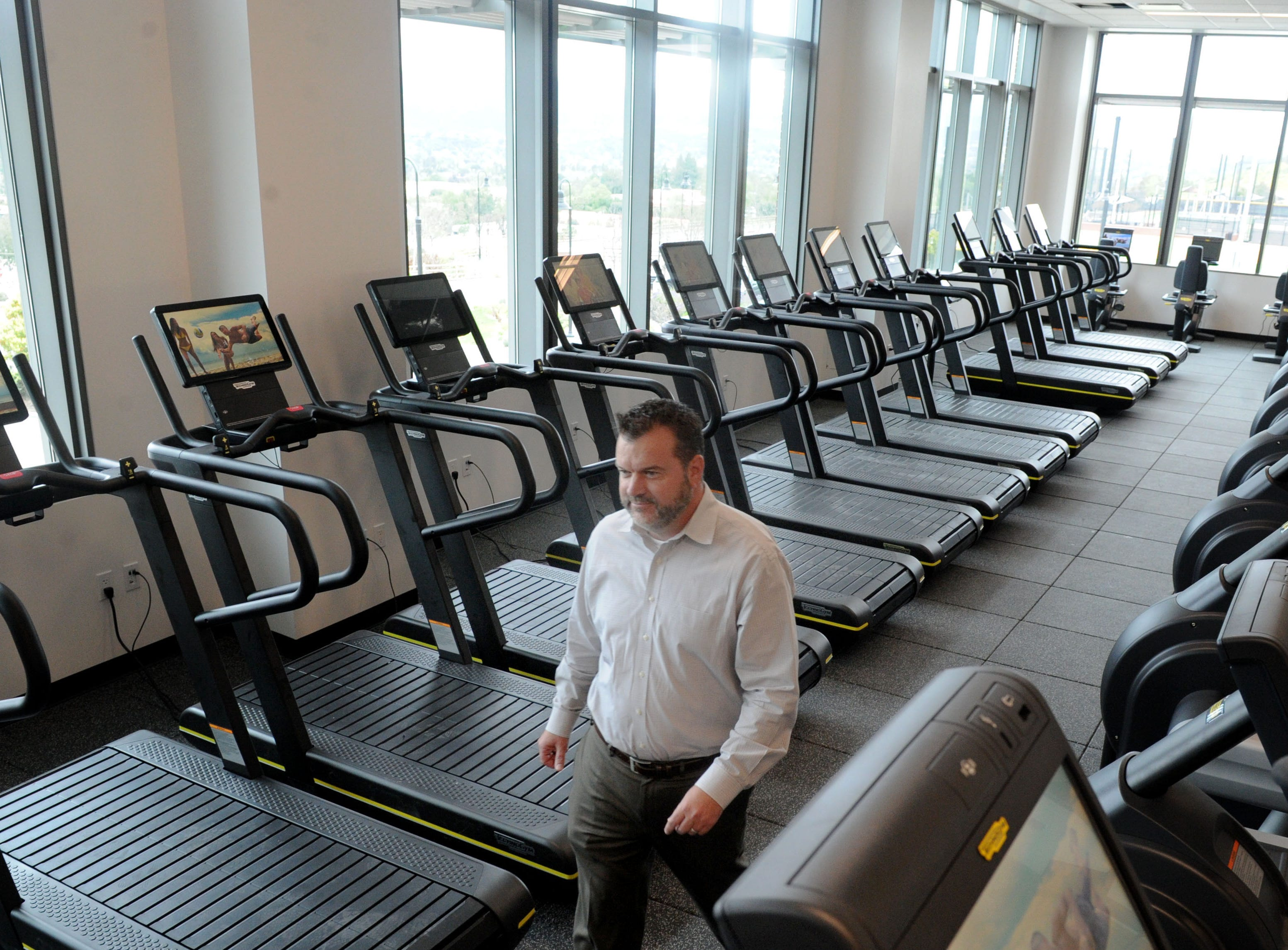 Ronnie Stone, CEO of the Southeast Ventura County YMCA, walks through the gym of the new Yarrow Family YMCA in Westlake Village. The Y's grand opening is April 27.