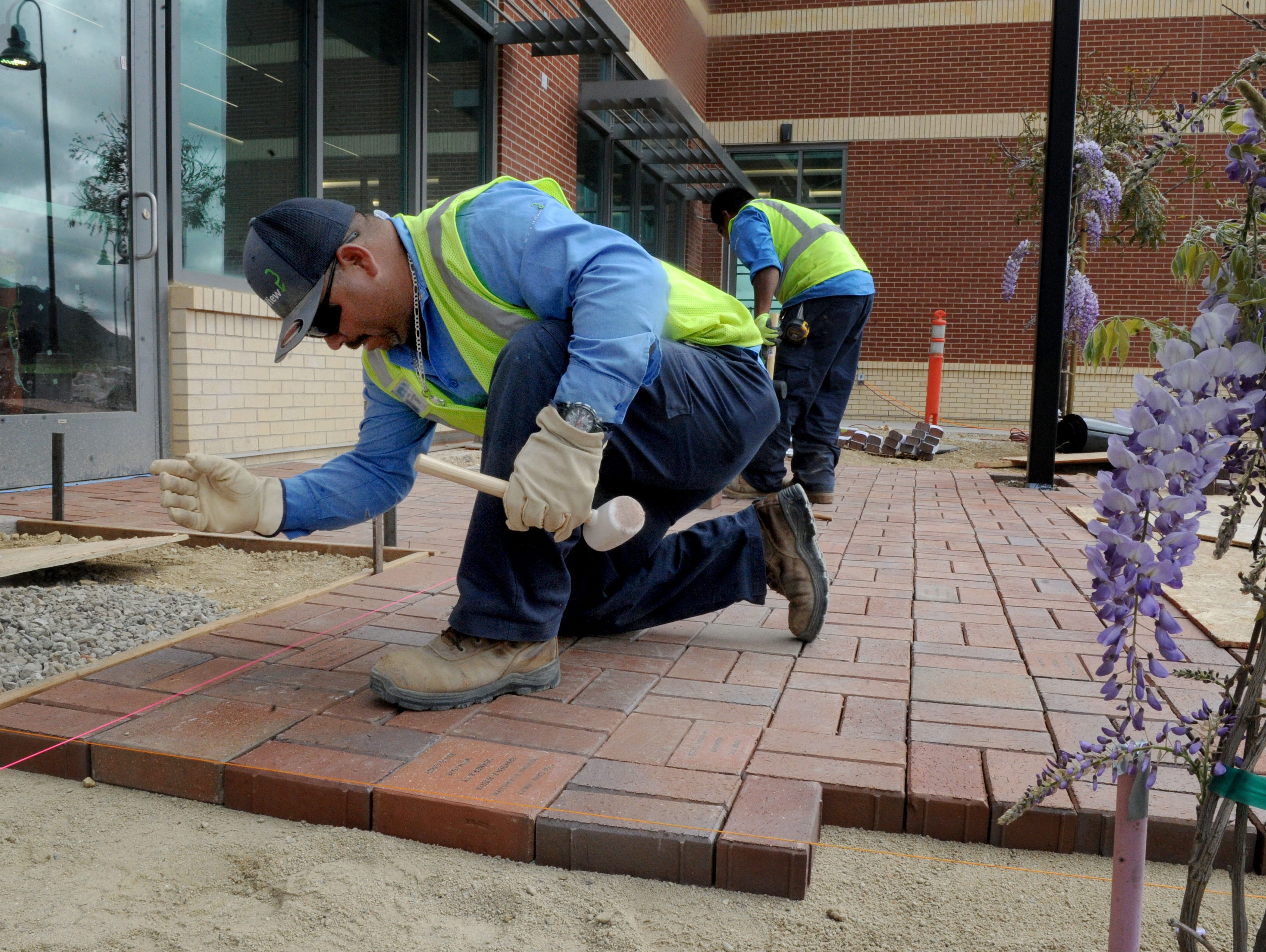 Pedro Medina works on the entrance of the Yarrow Family YMCA in Westlake Village. The Y's grand opening is April 27.
