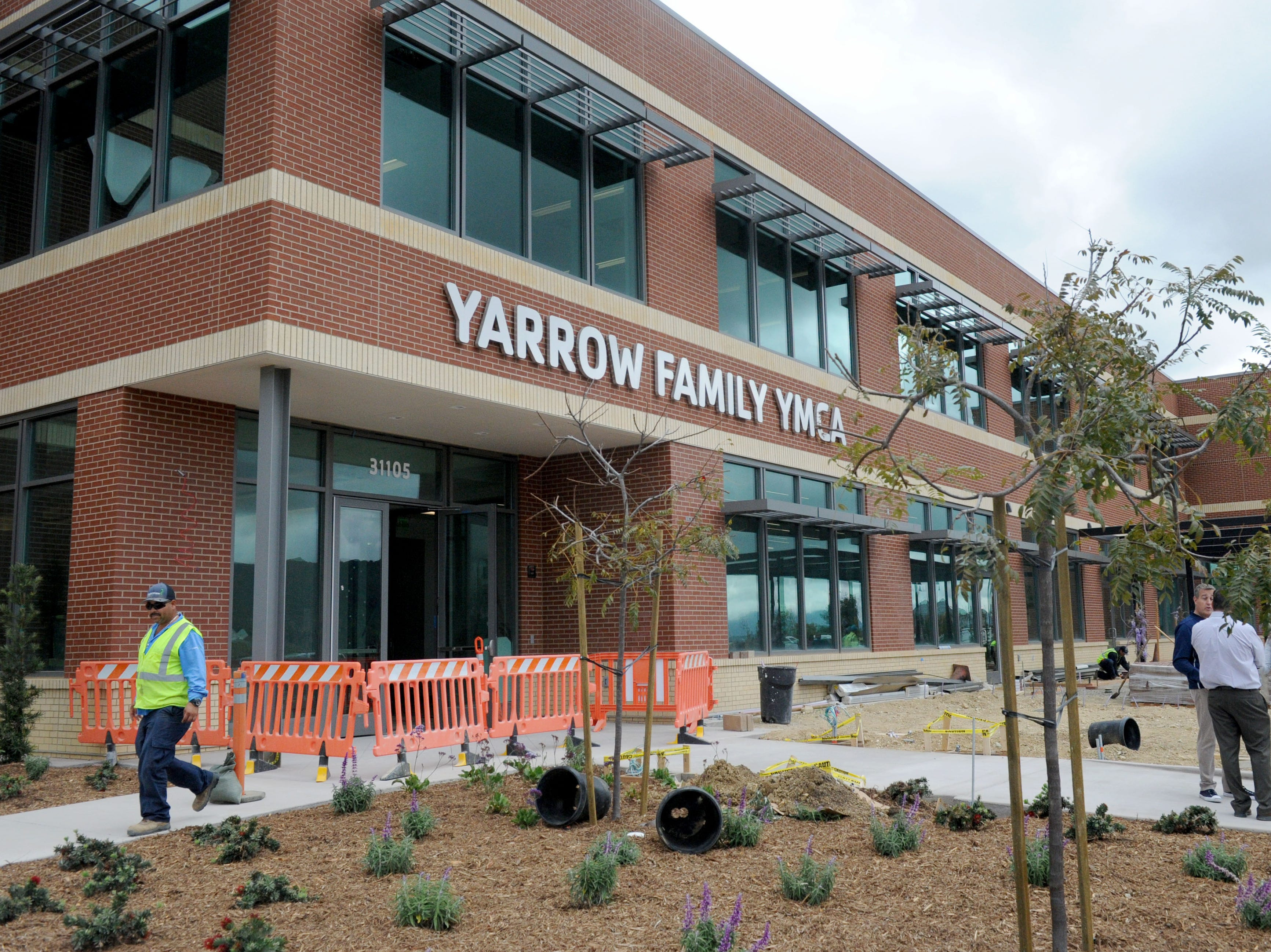 Landscape workers put the finishing touches on the Yarrow Family YMCA in Westlake Village. The facility's grand opening is April 27.