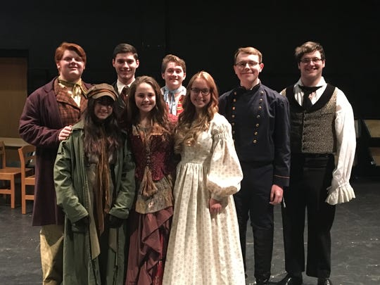 """(Front row, from left) Maia Morales as Eponine, Lauren Kavanagh as Madam Thenardier, Meaghan Airey as Cossette, and (back row, from left) John Chiarello as Thenardier, Kyle Crawford as Marius, Robert Williams as Enjolras, Aaron Benfer as Javert, Matthew Dugan as Jean Valjean are among the cast members for Millville High School's production of """"Les Miserables,"""" which opens April 11."""