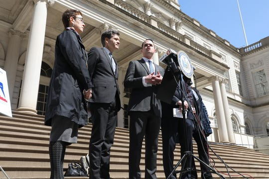 Sen. David Carlucci, third from left, speaks at a news conference at City Hall in New York City. Lawmakers and medical experts gathered to speak about the measles outbreak in New York, and possible legislation that would end the religious exemptions from vaccinations in the state.