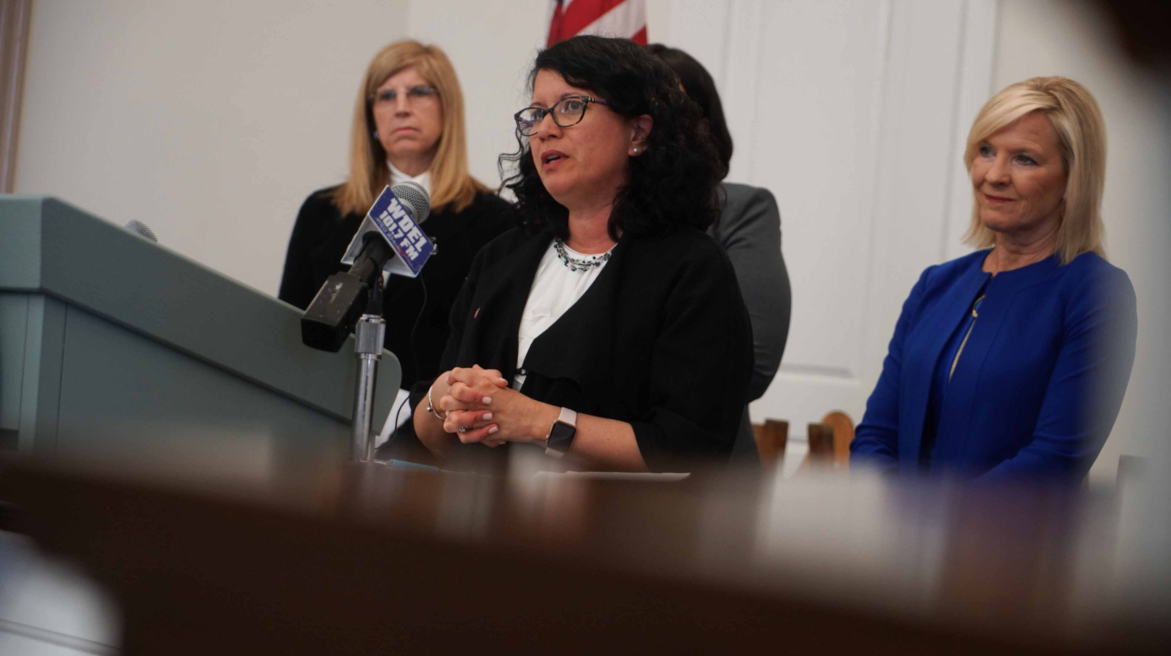Elizabeth Romero, director at Delaware Division of Substance Abuse and Mental Health, speaks at a press conference where the Pew Charitable Trusts gave a recommendation to the state's Behavioral Health Consortium.
