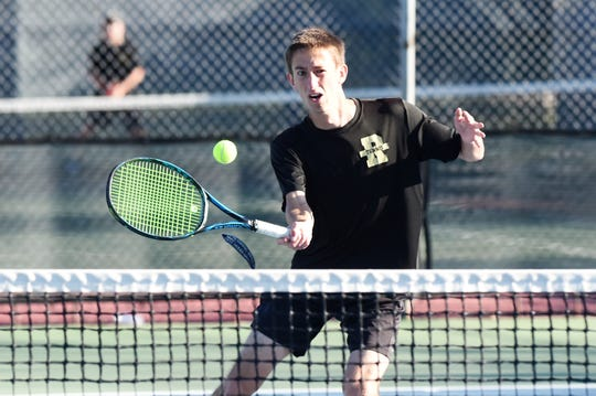 Rider's Chris Selsor returns a shot in Thursday's mixed doubles final at the 4-5A Tournament.
