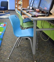 Colorful, sturdy, lightweight chairs are being purchased for the Wichita Falls Public Library's childrens department. A Chair-ity Art Auction is helping fund the effort.