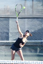 Rider's Julia Chon serves during Thursday's mixed doubles final at the 4-5A Tournament.