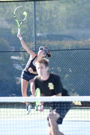 Rider's Julia Chon serves while mixed double partner Chris Selsor waits at the net Thursday at the District 4-5A Tournament.