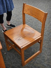 One of the heavy, rigid oak chairs that administrators of the Wichita Falls Public Library wants to replace with more kid-friendly versions with funds raised through the Chair-ity Art Auction.