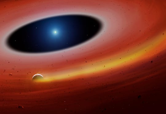 Concept of an artist about a planetary fragment in orbit around a distant white dwarf star. A fragment leaves behind a gas