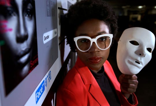 Massachusetts Institute of Technology facial recognition researcher Joy Buolamwini on Feb. 13, 2019, at the school, in Cambridge, Mass. Her research has uncovered racial and gender bias in facial analysis tools sold by companies such as Amazon that have a hard time recognizing certain faces, especially darker-skinned women. Buolamwini holds a white mask she had to use so that software could detect her face.