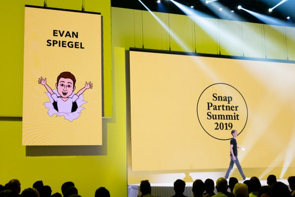 Snap CEOP Evan Spiegel strutting onstage for the Snap Partner Summit