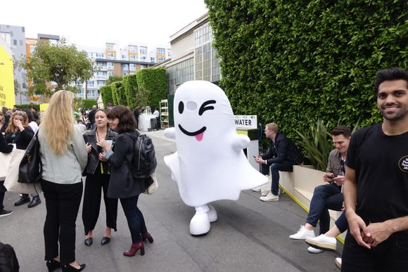 The Snapchat ghost makes its way around the backlot of the former Hollywood Warner studio