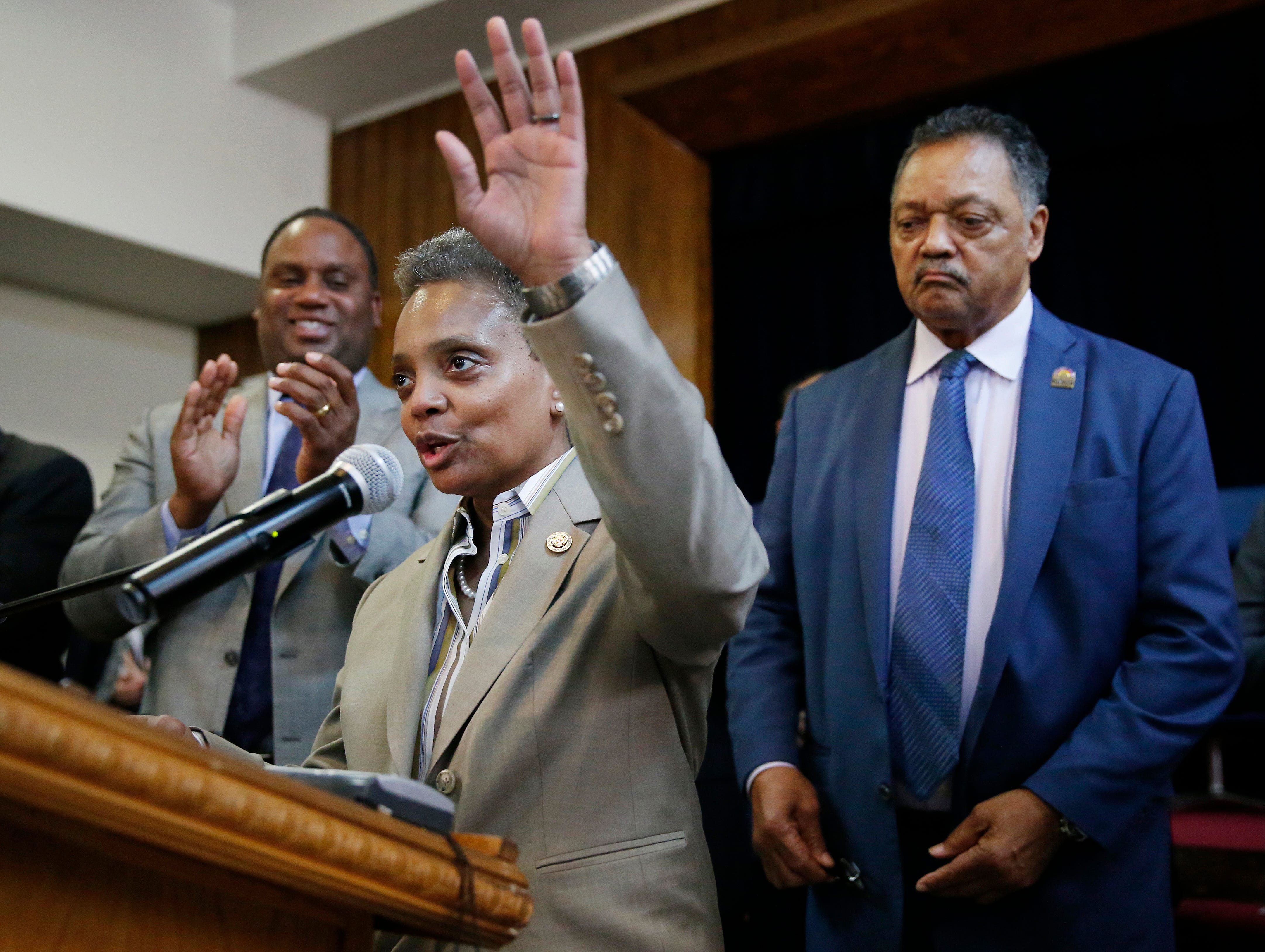 Chicago Mayor-elect Lori Lightfoot, speaks as Rev. Jesse Jackson, right, looks on during a press conference at the Rainbow PUSH organization on April 3, 2019, in Chicago. Lightfoot, a former federal prosecutor who'd never been elected to public office, defeated Cook County Board President and longtime City Council member Toni Preckwinkle.