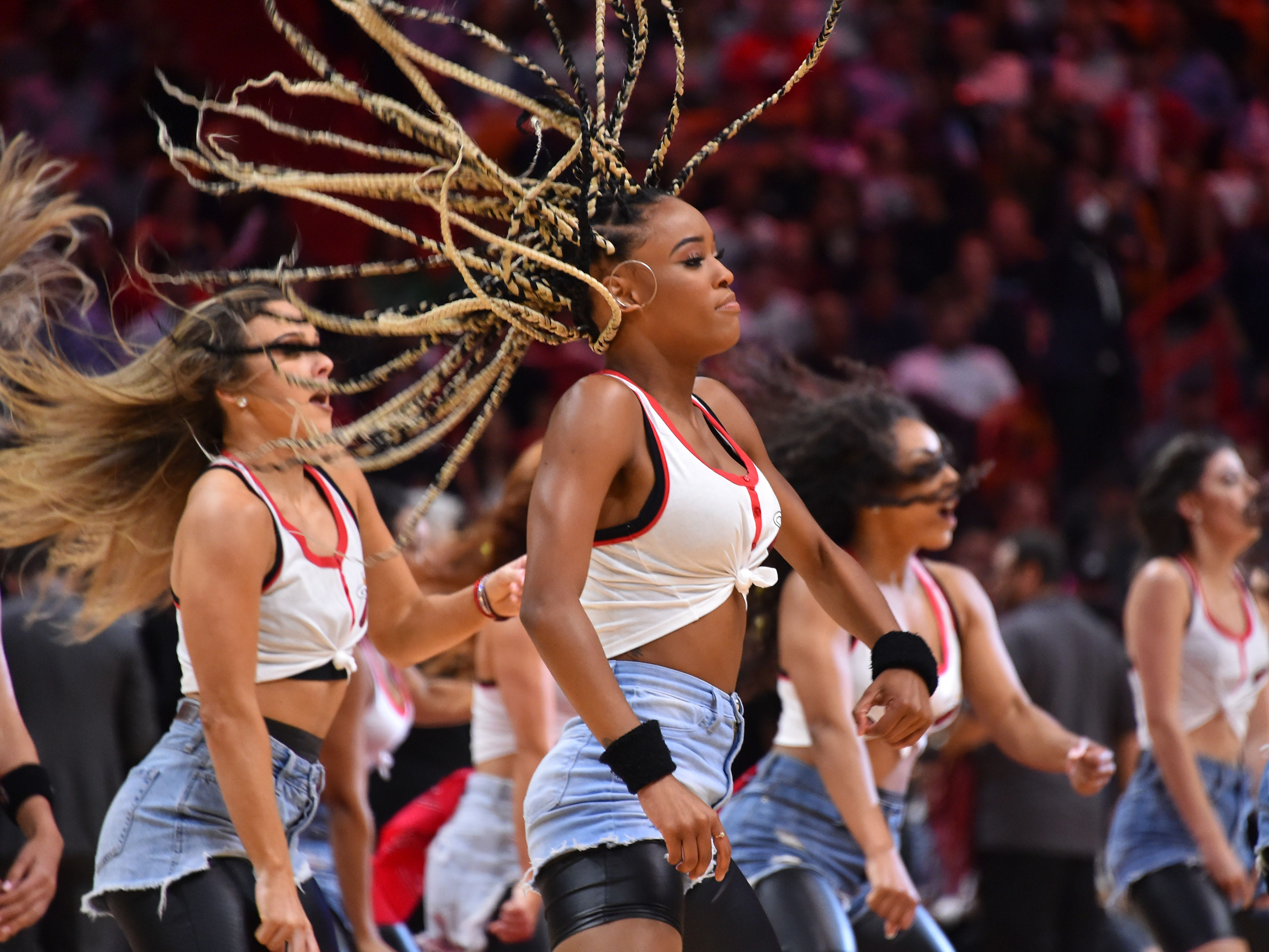 April 3, 2019: Miami Heat cheerleaders dance during a break in the action at American Airlines Arena.