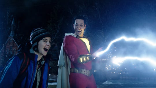 Freddy (Jack Dylan Grazer, left) helps test out Shazam's (Zachary Levi) powers. Talking to fish is not one of them.
