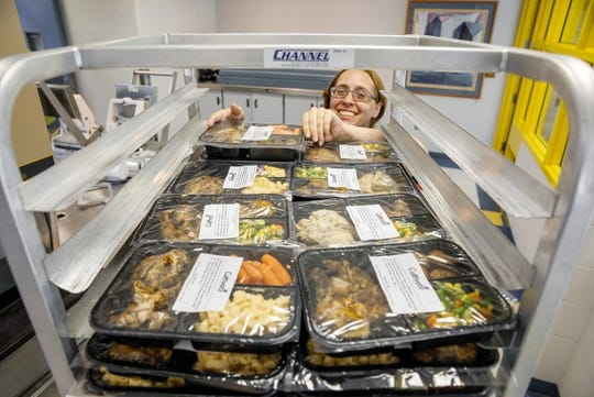 A pilot program involving five Indiana schools and a local non-profit seeks to provide to-go meals for students in need by making use of excess cafeteria food.