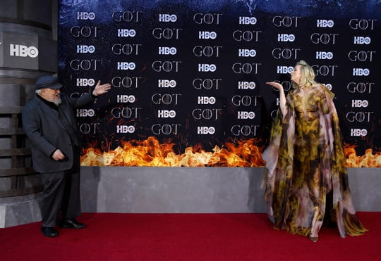 """British actress Gwendoline Christie, right, blows a kiss to novelist George R.R. Martin as they arrive for the New York red carpet premiere of the eighth and final season of """"Game of Thrones"""" at Radio City Music Hall in New York on April 3."""