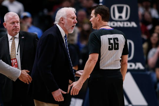 San Antonio Spurs head coach Gregg Popovich argues a call with referee Mark Ayotte.