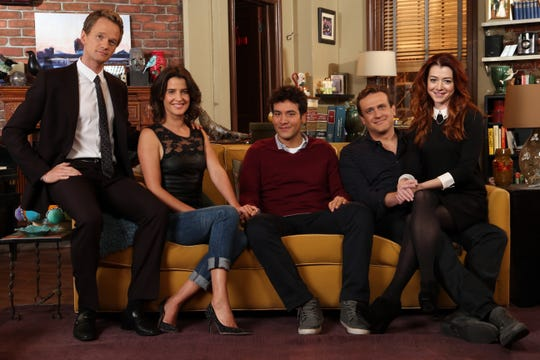 "The cast of ""How I Met Your Mother"" poses on the set of the sitcom ahead of its 2014 finale. From left to right: Harris, Cobie Smulders, Josh Radnor, Jason Segel and Alyson Hannigan."