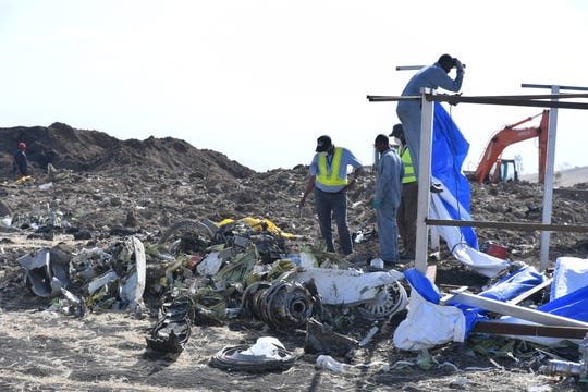 Rescue workers search the site for pieces of the wreckage of an Ethiopia Airlines Boeing 737 Max 8 aircraft near Bishoftu, Ethiopia, on March 13, 2019.