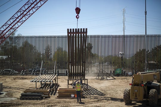 Rebuilding the border wall a year ago in Calexico, California, where President Donald Trump will visit on April 5, 2019.