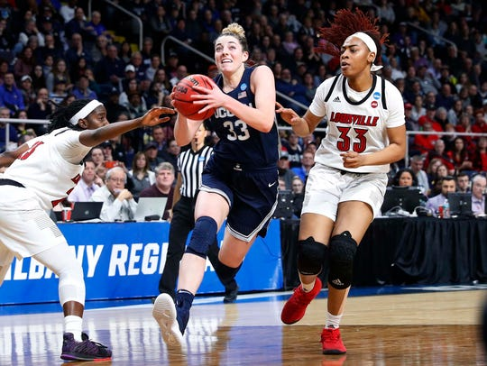 Connecticut guard Katie Lou Samuelson drives to the basket against Louisville during the championship game of the Albany Regional in the 2019 NCAA tournament.