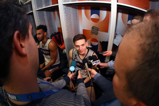 Kyle Guy of the Virginia Cavaliers speaks to the media in the locker room prior to the 2019 NCAA Tournament Final Four at U.S. Bank Stadium on April 4, 2019 in Minneapolis, Minnesota.