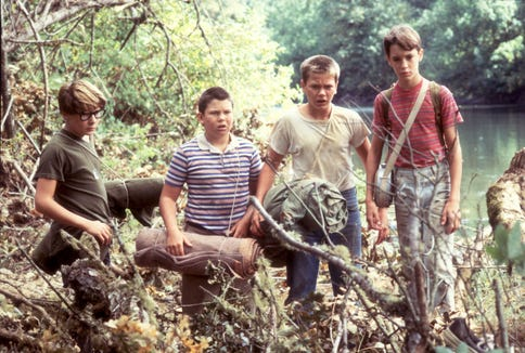 "Corey Feldman, from left, Jerry O'Connell, River Phoenix and Wil Wheaton star as friends searching for a dead body in ""Stand By Me."""