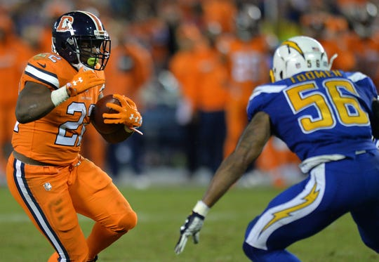 C.J. Anderson dons the Broncos' Color Rush uniforms in a game against the Chargers in 2016.