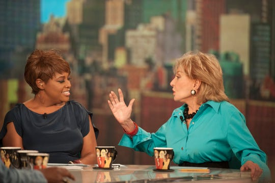 "Sherri Shepherd shares ""The View"" stage with Barbara Walters."