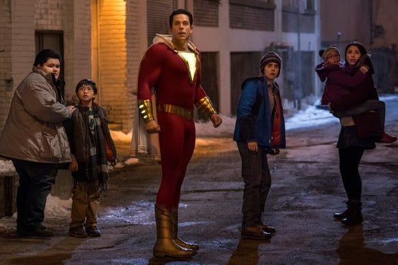 As Shazam, Billy Batson (Zachary Levi, center) protects his foster siblings Pedro (Jovan Armand), Eugene (Ian Chen), Freddy (Jack Dylan Grazer), Darla (Faithe Herman) and Mary (Grace Fulton).