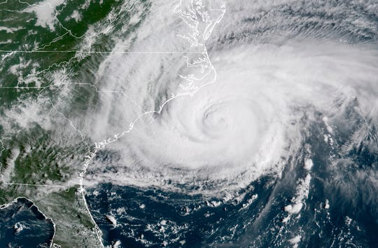 This file photo shows a satellite image provided by NOAA showing Hurricane Florence on the eastern coast of the United States.